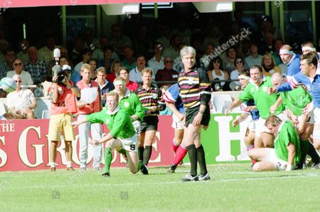 Scrum half Niall Hogan of Northern Ireland, no. 9, gets the ball away from a lineout during the Rugby Union World Cup Quarter Final Match between Northern Ireland and France, at Kings Park Stadium, Durban, on . France defeated Northern Ireland 36-12. Referee Ed Morrison of England, in stripes, watches the play