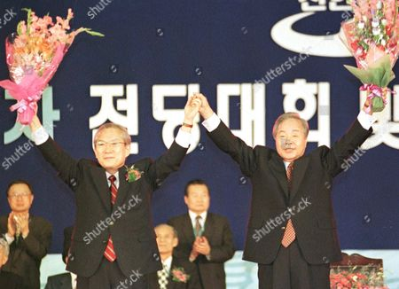 KIM LEE South Korean President Kim Young-sam, right, and Rep. Lee Hoi-chang wave their hands after Lee was selected the candidate of the ruling New Korea Party for the coming December presidential election at the Chansil Gymnastics Stadium in Seoul