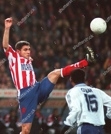 VIERI Atletico Madrid's Italian striker Cristian Vieri stretches for a high ball watched by Zaragoza's Brazilian defender Gilmar Jorge dos Santos during their 2nd leg Kings Cup tie in Madrid