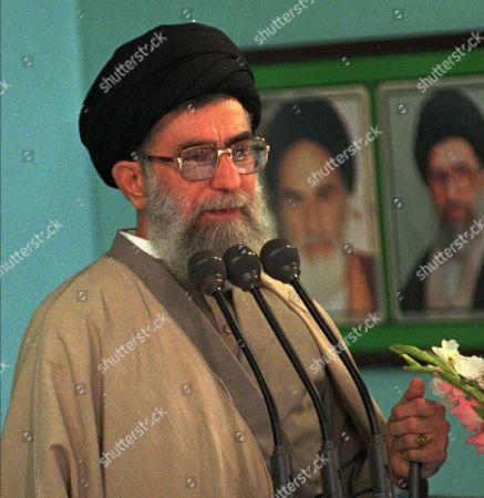 TEHRAN Leader of the Islamic Revolution of Iran, Ayatollah Seyyed Ali Khameini speaks at the 1000th friday prayers of Tehran Friday Oct. 30,1998. Two pictures are beside Ayatollah Khameini, Late Imam Khomeini, left, and Ayatollah Khamenei, right