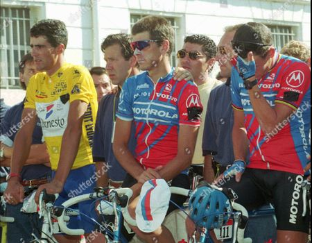 INDURAIN ANDREU ARMSTRONG Overall leader Miguel Indurain of Spain and Motorola teammates Frankie Andreu and Lance Armstrong of the USA (left to right), wearing a black ribbon on the shoulder, observe a minute of silence for Italian cyclist Fabio Casartelli prior to the start of the 16th stage of the Tour de France cycling race between Tarbes and Pau, southwestern France . Casartelli died during the 15th stage Tuesday after he fell while riding down the Portet d'Aspet pass in the Pyrenees mountains