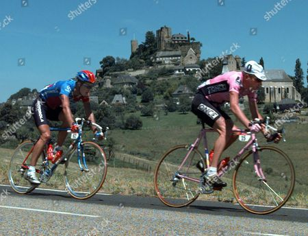 ANDREU JONKER Cyclists Frankie Andreu from Dearborn, Mich., left, and Patrick Jonker of Australia ride past the village of Turenne during the 15th stage of the Tour de France cycling race between Brive-la-Gaillarde and Villeneuve-sur-Lot, southwestern France