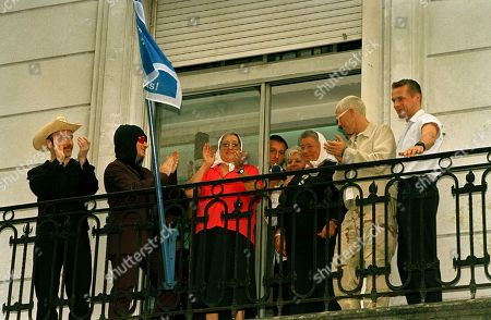 Mothers of The Plaza de Mayo and musicians of the Irish rock band U2, greet the band's fans from the balcony of the Mothers' House in Buenos Aires. From left: The Edge, Bono, mothers Hebe de Bonafini, and Ana Barimbaum, Adam Clayton and Larry Muller. The Irish group will give three concerts in Argentina