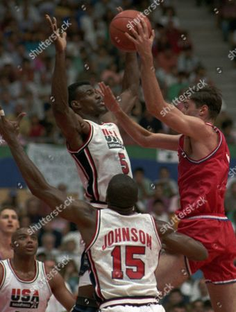 """ROBINSON JOHNSON KUKOC USA's David Robinson goes up to block Croatia's Toni Kukoc during the gold medal basketball game at the Summer Olympics in Barcelona . Earvin """"Magic"""" Johnson is in foreground"""