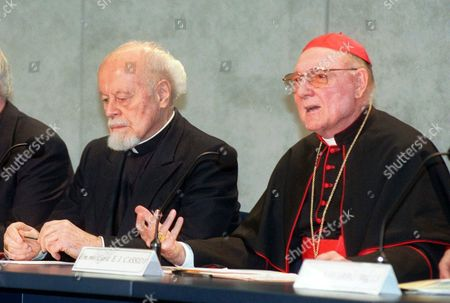 """Stock Photo of CASSIDY DUPREY Australian Cardinal Edward Cassidy, president of the Commission for Religious Relations with the Jews, right, gestures as he reads the document promised by Pope John Paul II to Jewish groups and released by the Vatican, on the role the church might have had during the Holocaust. The Vatican expressed deep regret for the """"errors and failures"""" of Roman Catholics during the Holocaust, but strongly defended wartime Pope Pius XII. At left, French Bishop Pierre Duprey, vice president of the commission"""