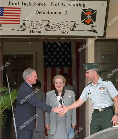 ALBRIGHT, PETERSON, CHASE U.S. Secretary of State Madeleine Albright, center, and Ambassador Pete Peterson, left, are greeted by Col. Jonathan Chase, who heads the Hanoi office of the Joint Task Force for Full Accounting of Americian servicemen still missing from the Vietnam War in Hanoi . Albright said the search for American MIAs remains Washington's top priority in relations with Vietnam