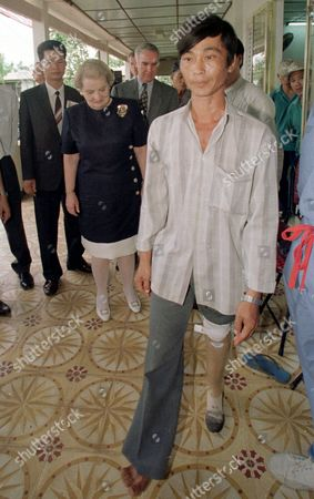 Stock Picture of THANH U.S. Secertary of State Madeleine Albright, second from left, watches Nguyen Van Thanh, 35, a landmine victim as he takes his first few steps after receiving his new prosthetic leg at the Thu Duc Prothetics and Vocational Training Center on the outskirts of Ho Chi Minh City . Albright also visited the Operation Smile, a NGO (non-government organization) treating children with facial deformaties, before leaving to join the turnover ceremonies in Hong Kong
