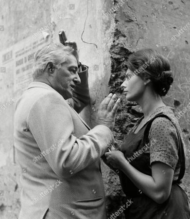 "Stock Photo of Vittorio De Sica, Sophia Loren Italy's Sophia Loren, in costume for a new film presently being shot in Rome, talks with the director of the picture, Italy's actor-producer-director Vittorio De Sica, during a break in the shooting in Rome, . The new movie is called ""La Ciociara"" about a woman from the Ciociaria region in the mountains south of Rome. It is based on a novel by the same title by Italian author Alberto Moravia, and stars Sophia Loren opposite Italian actor Raf Vallone"