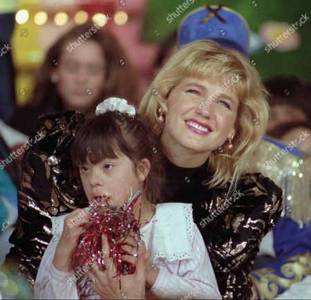 Stock Picture of XUXA Brazilian entertainer Xuxa embraces a little girl during the taping of a show in Buenos Aires, Argentina, in this August 1991 photo. Police have arrested a man for trying to shoot Xuxa, Brazil's queen of children's television. Ronaldo dos Santos was overpowered Wednesday night, as he fired a pistol at the entertainer during a taping session at Rio's Fenix theater, a policeman said. The pistol failed to go off, and the performer, whose full name is Xuxa Meneghel, was unhurt, said the policeman, speaking on condition of anonymity. He declined to give more details