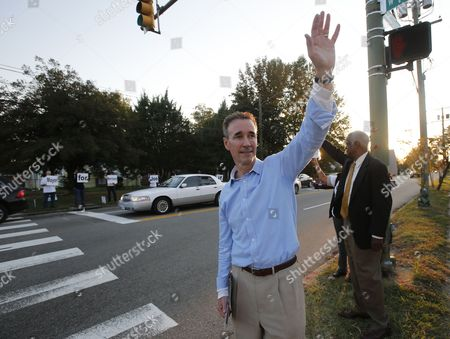 Joe Morrissey Richmond, Va., mayoral candidate Joe Morrissey waves to supporters as he campaigns on a busy street corner in Richmond, Va. At right is former councilman, Marty Jewell. On Friday, Nov. 4, 2016, the Henrico County Commonwealth's Attorney said Morrissey won't face criminal charges following allegations he pressured a legal client for sex