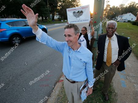 Joe Morrissey Richmond mayoral candidate, former Del. Joe Morrissey, front, waves to supporters along with former Richmond City Councilman, Marty Jewell, right, and supporter Gloria Guiterrez, center, as he campaigns on a busy street corner in Richmond, Va., . On Friday, Nov. 4, 2016, the Henrico County Commonwealth's Attorney said Morrissey won't face criminal charges following allegations he pressured a legal client for sex