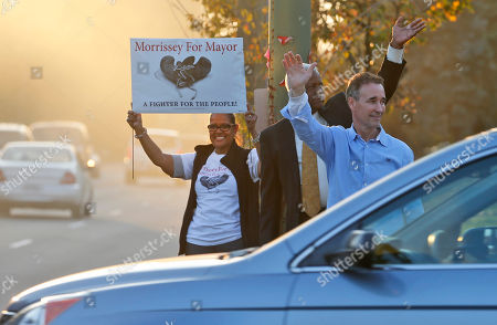 Joe Morrissey Richmond mayoral candidate, former Del. Joe Morrissey, right, waves to supporters along with former Richmond City Councilman, Marty Jewell, center, and supporter Gloria Guiterrez, left, as he campaigns on a busy street corner in Richmond, Va., . On Friday, Nov. 4, 2016, the Henrico County Commonwealth's attorney said Morrissey won't face criminal charges following allegations he pressured a legal client for sex