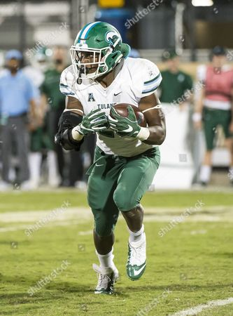 Stock Photo of Orlando, FL, U.S: Tulane Green Wave running back Dontrell Hilliard (26) during 2nd half NCAA football game. UCF defeated Tulane 37-6 at Bright House Networks Stadium in Orlando, Fl