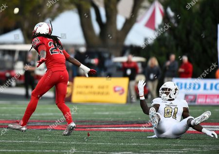 Western Kentucky defensive back Leverick Johnson (29) cheers after forcing an incomplete pass by Florida International wide receiver Thomas Owens (81) in an NCAA college football game, in Bowling Green, Ky