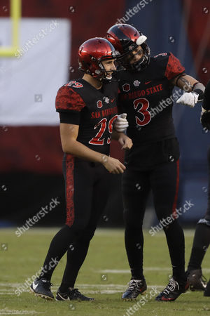 San Diego State place kicker John Baron II, left, celebrates his field goal with teammate Trey Lomax during the first half of an NCAA college football game against Hawaii, in San Diego