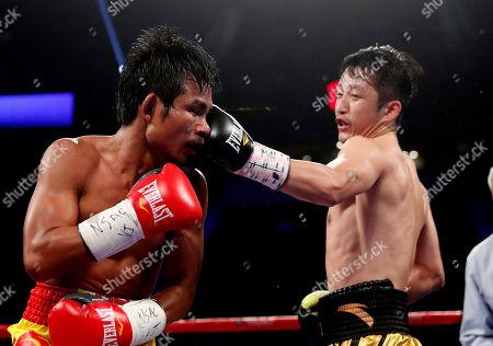Prasitak Phaprom, Zou Shiming Zou Shiming, of China, right punches Prasitak Phaprom, of Thailand, during their WBO flyweight title boxing match, in Las Vegas. Zou won by unanimous decision