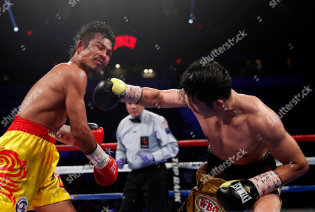 Stock Picture of Prasitak Phaprom, Zou Shiming Zou Shiming, right, of China, punches Prasitak Phaprom, of Thailand, during their WBO flyweight title boxing match, in Las Vegas. Zou won by unanimous decision