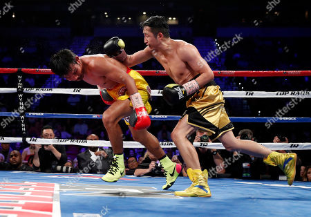 Stock Photo of Prasitak Phaprom, Zou Shiming Zou Shiming, right, of China, punches Prasitak Phaprom, of Thailand, during their WBO flyweight title boxing match, in Las Vegas. Zou won by unanimous decision