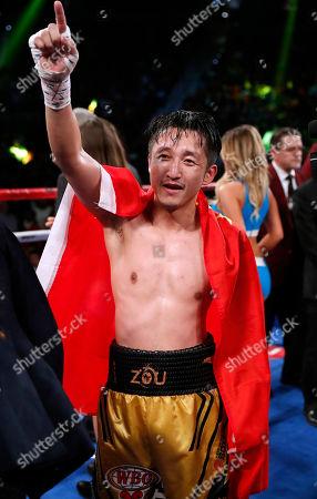 Prasitak Phaprom, Zou Shiming Zou Shiming, of China, celebrates after defeating Prasitak Phaprom, of Thailand, in a WBO flyweight title boxing match, in Las Vegas. Zou won by unanimous decision