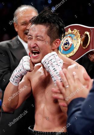 Stock Image of Prasitak Phaprom, Zou Shiming Zou Shiming, of China, celebrates after defeating Prasitak Phaprom, of Thailand, in a WBO flyweight title boxing match, in Las Vegas. Zou won by unanimous decision