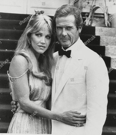 "Stock Image of Tanya Roberts, Victoria Leigh Blum, Roger Moore Popular British actor Roger Moore poses as James Bond, 007 British secret agent, with New York-born actress Tanya Roberts in the next 007 adventure ""A View to a Kill,"" the fourteenth of he Albert R. Broccoli presentation series, in front of Chantilly castle outside of Paris"