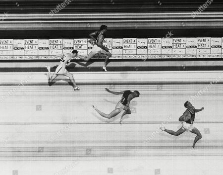 The official photo finish of the men's 400 meters hurdles event at the Olympic games in Rome . It shows Glenn Davis of the U.S. winning from his compatriots Clifton Cushman nearest camera and Richard Howard, in the distance in 49.3 seconds