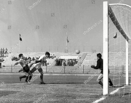 Yugoslavia's forward Drazen Jerkovic, third left, heads the ball towards the net past Uruguayan goalkeeper Roberto Sosa to score his team's third goal during the Football World Cup match in Arica, Chile, on . Uruguayan defender Horatio Troche, first left, attempts to stop Jercovic. Yugoslavia won the match 3-1