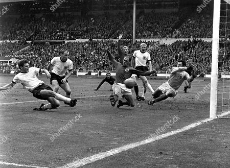 London soccer wc With thirty-seconds to go in the World Cup final, West Germany's Wolfgang Weber, far left, side-foots the ball past England's goalkeeper Gordon Banks to snatch the equaliser at Wembley Stadium, London, . In extra-time that followed England scored twice to end up winning the match 4-2. Seen, from left to right, Weber, Uwe Seeler, George Cohen, Ray Wilson, foreground, Bobby Moore, Karl-Heinz Schnellinger, Banks, and Jack Charlton