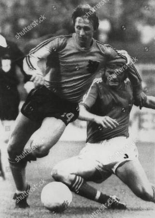 Johann Cruyff, Kent Karlsson Dutch soccer ace Johann Cruyff, left, is seen in action during match vs. Sweden in the Eestfalen Stadium at Dortmund, West Germany, . Right is Swedish Kent Karlsson