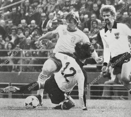 Austria's Eduard Krieger, back to camera, tackles Sweden's Anders Lineroth, centre, during the Football World Cup match between Austria and Brazil in Buenos Aires on . Austria;s Herbert Prohaska watches the action. Austria defeated Sweden 1-0