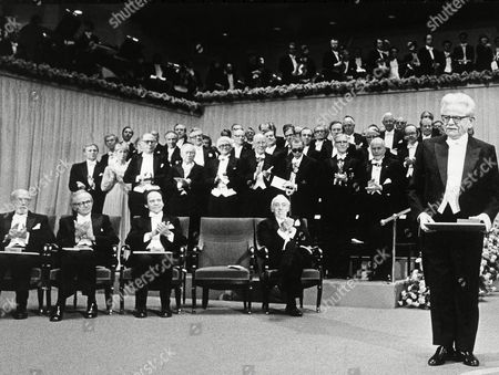 Nobel Literature winner Elias Canetti, right, is applauded after he received his prize during ceremonies at Stockholm's Concert Hall . Seated Nobel laureates are, from left, Dr. Roger Sperry, Medicine; Prof. David H. Hubel, Medicine; Prof. Torsten Wiesel, Medicine; and Prf. James Tobin, Economics