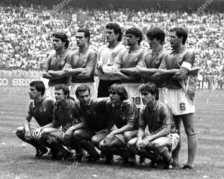 Stock Picture of The Italian team pose for photographers before the start of the Football World Cup match between Italy and Bulgaria in Mexico City, Mexico on . Back row standing from left to right;Antonio Di Gennaro, Giseppe Bergomi, Giovanni Galli, Alessandro Altobelli, Fernando De Napoli, Gaetano Scirea. Front row from left to right; Salvatore Bagni, Pietro Vierchowod, Antonio Cabrini, Bruno Conti, Giuseppe Galderisi. The match ended in a 1-1 draw