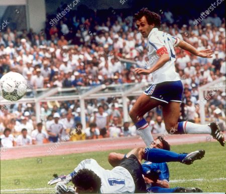 Stock Photo of WORLD CUP French ace Michel Platini gives France a 1-0 lead over Italy beating Italian goalkeeper Giovanni Galli and defender Antonio Cabrini (partially hidden) in the first half of their World Cup eightfinals in Mexico City's Azteca Stadium on
