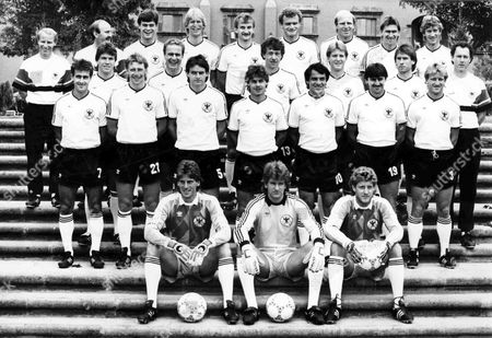 West German World Cup soccer team pose for photographers at their headquarters in Galindo, near Queretaro, Mexico on . From left to right back row; Assistant coaches Berti Vogts and Horst Koeppel, Thomas Berthold, Uwe Rahn, Rudi Voeller, Hans-Peter Briegel, Dieter Honess, Klaus Augenthaler, Ditmar Jakobs. Left to right third row; Lothar Matthaeus, Karl-Heinz Rummenigge, Karl Allgoewer, Karl-Heinz Foerster, Norbert Eder, Coach Franz Beckenbauer. Second row left to right; Pierre Littbarski, Wolfgang Rolff, Matthias Herget, Olaf Thon, Felix Magath, Klaus Allofs, Andreas Brehme. Goalkeepers in front left to right; Urich Stein, Elke Immel, Harald Schumacher