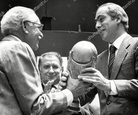 Governor of the state of Mexico Alfredo Barauda Garcia, right, receives the FIFA World Cup trophy from Organizing Committee Treasurer Ignacio Gomez Urquiza, left, in Toluca, Mexico, on . From May 31 onwards 24 countries will compete in the Football World Cup Tournament