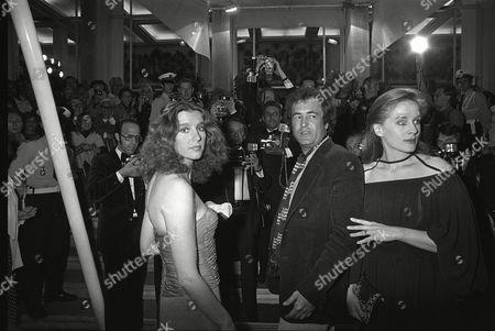 "Italian actress Stefania Sandrelli, Italian director Bernardo Bertolucci and French actress Dominique Sanda arrive at the Festival Palace in Cannes to present the Italian film ""Novecento"" at the 30th Cannes Film Festival in Cannes, France on"