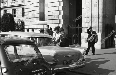 Charles Boyer Actor Charles Boyer, in hat and dark glasses, is helped into cab on his way to Paris, Orly Airport . The veteran actor is en route to the United States where his son, Michael Charles Boyer, apparently killed himself in Beverly Hills the night before