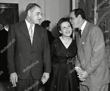 "From left to right are Alberto Moravia, author of ""The Woman of Rome,"" and ""The Conformist""; Flora Volpini, author of ""The Woman of Florence"" and Marc Lawrence, Hollywood tough guy of the movies, pose together in Rome"
