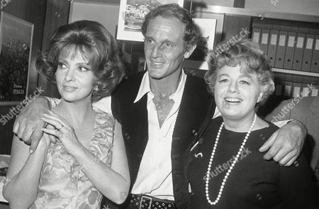 "Philippe Leroy, Gina Lollobrigida; Shelley Winters From left to right are: Italy's Gina Lollobrigida; French actor Philippe Leroy; and American actress Shelley Winters pose together on in a studio of Rome's ""Cinecitta"" (Movie City), during a party to celebrate the start of the shooting of a new film, ""Buona Sera, Mrs. Campbell."" The movie is produced and directed by American Melvin Frank, who also has written the original screenplay. It stars Miss Lollobrigida as a clever, daring and ambitious Mrs. Campbell, opposite Philippe Leroy and with a star cast including Shelley Winters, Peter Lawford and Lee Grant"