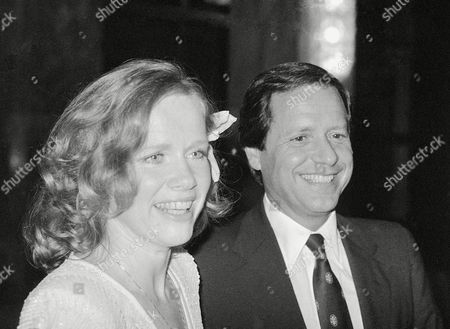 Actress Liv Ullman smiles with her new husband Donald Saunders during their wedding party in a Rome hotel . The couple was married in a civil ceremony earlier