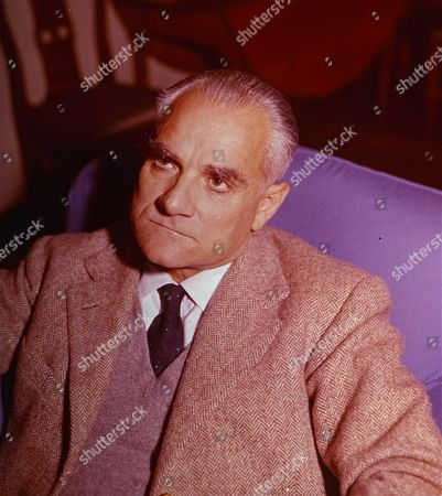 This is an photo of writer Alberto Moravia, sitting in his home in Rome, Italy