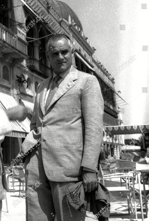 "ALBERTO MORAVIA Alberto Moravia, author of best seller, ""The Women of Rome"", has written the story of the film ""La Romana"" which is an adaptation of the same novel. Gina Lollabrigida takes the main role in the film which is being presented at the Venice film festival"
