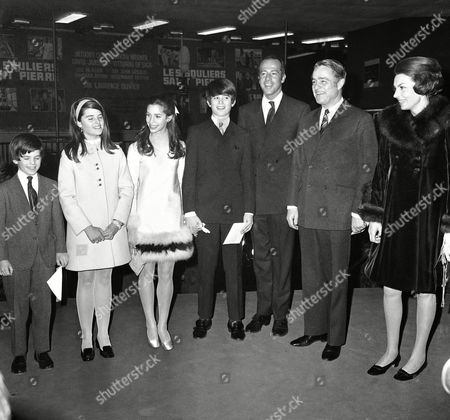 """Sargent Shriver U.S. Ambassador to France, Sargent Shriver, with his children, in Paris for the Premiere in Paris of """"Les Souliers de Saint-Pierro"""" (Saint-Peter's shoes). They are pictured on their arrival: left to right: Timothy Shriver; Maria Shriver; Joy Sterling: Robert Shriver: George Englund film producer; Ambassador Sargent Shriver and Mrs. Pierre Taittinger, a friend the wife of a French Senator"""