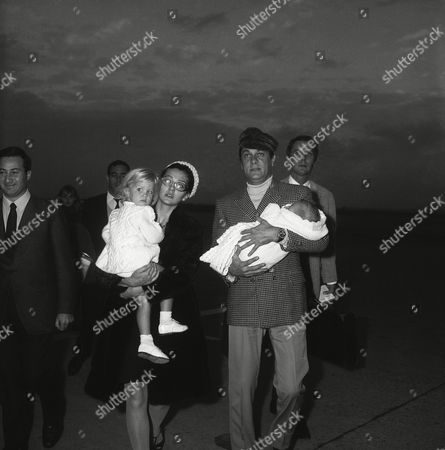 """Tony Curtis, Christine Kaufmann, Alessandra Curtis, Allegra Curtis American actor Tony Curtis, his wife, Christine Kaufman, and their two daughters, Alessandra (in the mother's arms) and Allegra (in the father's arms); arrive at Rome's Fiumicino airport . Tony Curtis has come to play the leading male part in a new film, """"La Cintura di Castita"""" (The Chastity Belt), the shooting of which will soon start under the direction of Italian Pasquale Festa Campanile, and with Italian actress Monica Vitti in the starring female part"""
