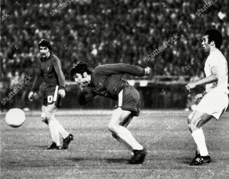Charlie Cooke; David Webb; Amancio Amaro Chelsea's Charlie Cooke and David Webb, outrace Spanish football club Real Madrid's Amancio Amaro, right, for the ball on during the European Cup of Cup Winners match at the Karaiskakis Stadium in Piraeus, near Athens, Greece