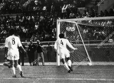 Real Madrid's Pirri, unseen, scores his team's only goal, in the replay of the European Cup of Cup Winners Final, in Athens, Greece, on . Other Real members, Amancio Amaro, no.8 and Pirri, no.4, the captain. Chelsea defeated Real 2-1