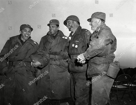 These four men were among a group of Army officers who were the closest to atomic explosion in Survival City, Nevada, in a trench 2600 yards from ground zero, and all came through the experience in good shape. From left to right: Maj. George L. Alexander of Oklahoma; Maj. Richard T. Weatherall of Minneapolis, Minn.; Lt. Col. John L. Beebe of Kansas; Capt. Karl Akin, Ontario, California
