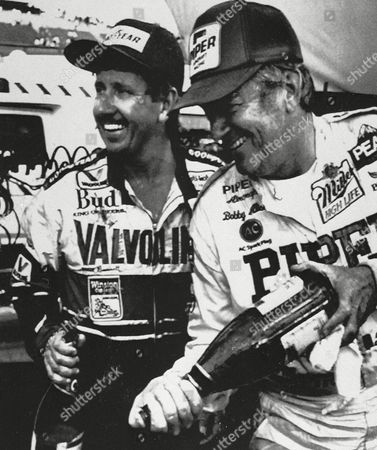 Bonnett Allison Neil Bonnett, left, winner of the $250,000 NASCAR 500 at Melbourne's Calder Park Raceway, and second place finisher Bobby Allison, both of Hueytown, Ala., spray photographers with champagne after the race, the first NASCAR race to be held outside the United States. It was Bonnett's second consecutive NASCAR victory