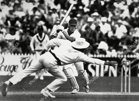 Opening batsman Chris Broad on his way to a century strikes this ball off Australian fast bowler Merv Hughes, to the boundry. But a chance for a catch was missed when Allan Border could not get his hand to the ball during play in the third test at Adelaide Oval in Adelaide, Australia on . The match ended in a draw
