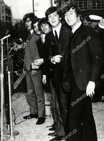 The Beatles on the balcony of the Southern Cross Hotel in Melbourne in their arrival in the Australian city,, and below them, sending up a riotous welcome, were 10,000 scream fans. From left: George Harrison, Jimmy Nicol, who had been substituting for Ringo Starr, Ringo Starr, Paul McCartney and John Lennon